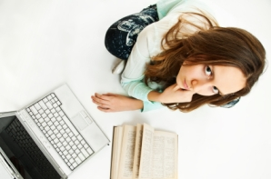 girl laptop and book