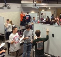 Engineering students at Clemson University work in small groups problem solving in the MyEngineeringLab classroom. More details at http://www.masteringengineeringcommunity.com/training-tips-guidance/case-studies/case-study-using-technology-and-active-learning-to-get-engineering-students-off-to-a-good-start/